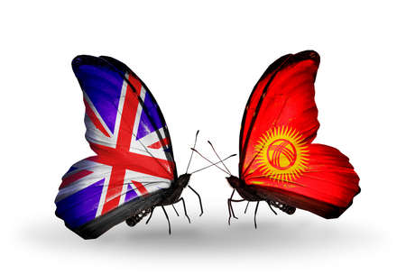 Two butterflies with flags on wings as symbol of relations UK and Kirghiz photo