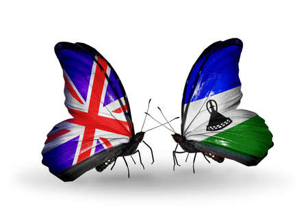 Two butterflies with flags on wings as symbol of relations UK and Laos photo