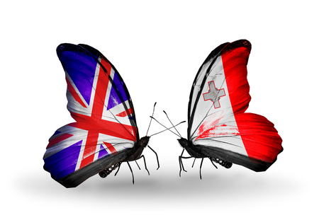 Two butterflies with flags on wings as symbol of relations UK and Malta photo