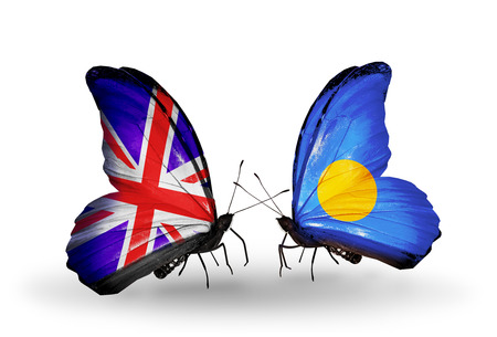 Two butterflies with flags on wings as symbol of relations UK and Palau photo