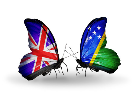 Two butterflies with flags on wings as symbol of relations UK and Solomon Islands photo