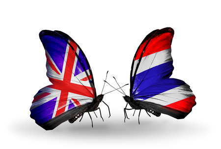 Two butterflies with flags on wings as symbol of relations UK and Thailand photo