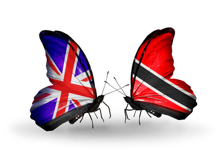 Two butterflies with flags on wings as symbol of relations UK and Trinidad and Tobago photo