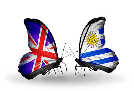 Two butterflies with flags on wings as symbol of relations UK and Uruguay photo