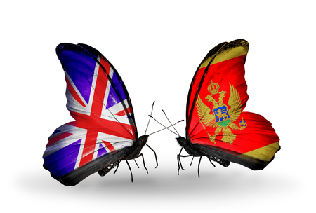 Two butterflies with flags on wings as symbol of relations UK and Montenegro photo
