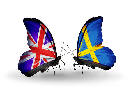 Two butterflies with flags on wings as symbol of relations UK and Sweden photo