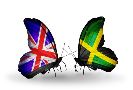 Two butterflies with flags on wings as symbol of relations UK and Jamaica photo