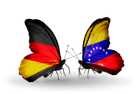 Two butterflies with flags on wings as symbol of relations Germany and Venezuela photo
