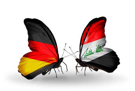 iraq money: Two butterflies with flags on wings as symbol of relations Germany and Iraq Stock Photo