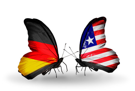 Two butterflies with flags on wings as symbol of relations Germany and Liberia photo