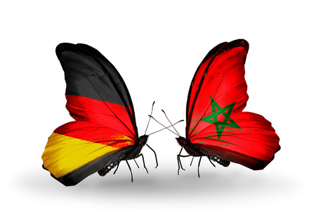 Two butterflies with flags on wings as symbol of relations Germany and Morocco photo