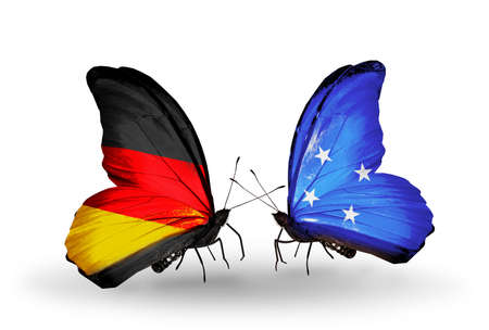 Two butterflies with flags on wings as symbol of relations Germany and Micronesia photo