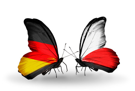 Two butterflies with flags on wings as symbol of relations Germany and Poland Stock Photo