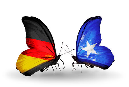 Two butterflies with flags on wings as symbol of relations Germany and Somalia photo