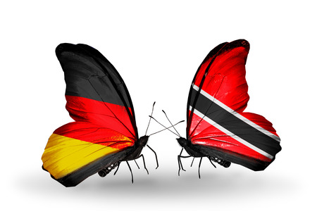 Two butterflies with flags on wings as symbol of relations Germany and Trinidad and Tobago