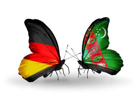 turkmenistan: Two butterflies with flags on wings as symbol of relations Germany and Turkmenistan