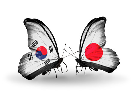 Two butterflies with flags on wings as symbol of relations South Korea and Japan