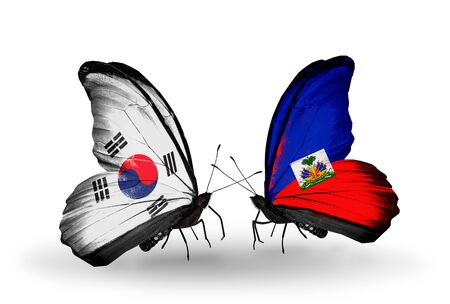 Two butterflies with flags on wings as symbol of relations South Korea and Haiti photo
