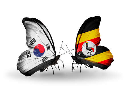 Two butterflies with flags on wings as symbol of relations South Korea and Uganda photo