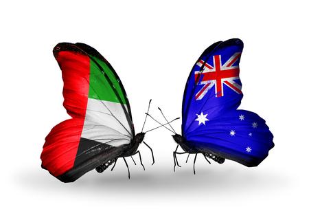 arabe: Dos mariposas con banderas en las alas como s�mbolo de las relaciones de Emiratos �rabes Unidos y Australia Foto de archivo