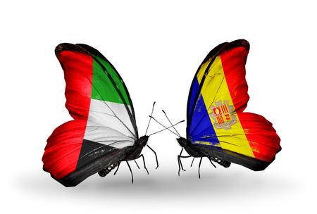 �rabe: Dos mariposas con banderas en las alas como s�mbolo de las relaciones de Emiratos �rabes Unidos y Andorra Foto de archivo