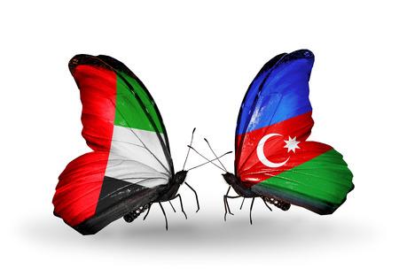 arabe: Dos mariposas con banderas en las alas como símbolo de las relaciones de Emiratos Árabes Unidos y Azerbaiyán