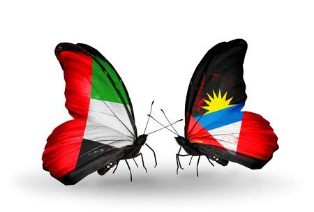 arabe: Dos mariposas con banderas en las alas como símbolo de las relaciones de Emiratos Árabes Unidos y Antigua y Barbuda