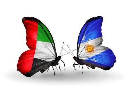 arabe: Dos mariposas con banderas en las alas como símbolo de las relaciones de Emiratos Árabes Unidos y Argentina
