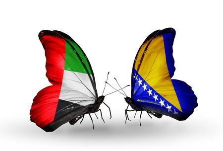 arabe: Dos mariposas con banderas en las alas como símbolo de las relaciones de Emiratos Árabes Unidos y Bosnia y Herzegovina