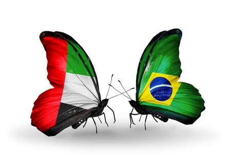 arabe: Dos mariposas con banderas en las alas como símbolo de las relaciones de Emiratos Árabes Unidos y Brasil Foto de archivo