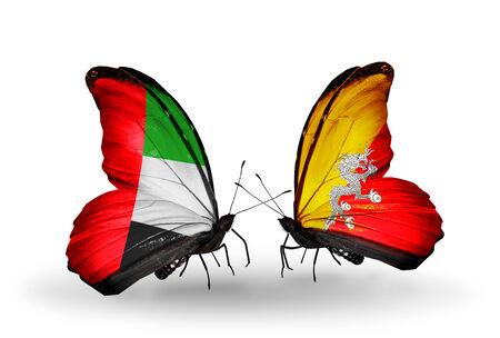 arabe: Dos mariposas con banderas en las alas como símbolo de las relaciones UAE y Bután