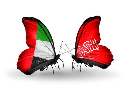 arabe: Dos mariposas con banderas en las alas como símbolo de las relaciones de Emiratos Árabes Unidos y Waziristán