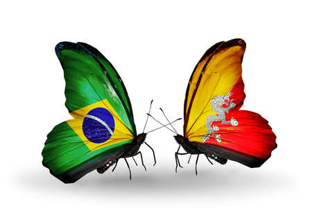 Two butterflies with flags on wings as symbol of relations Brazil and Bhutan Stock Photo