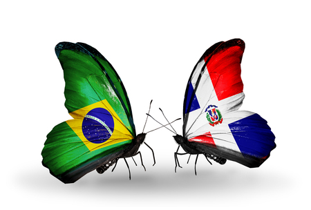 Two butterflies with flags on wings as symbol of relations Brazil and Dominicana photo