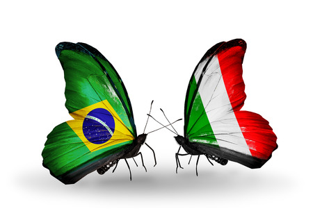 Two butterflies with flags on wings as symbol of relations Brazil and  Italy Zdjęcie Seryjne
