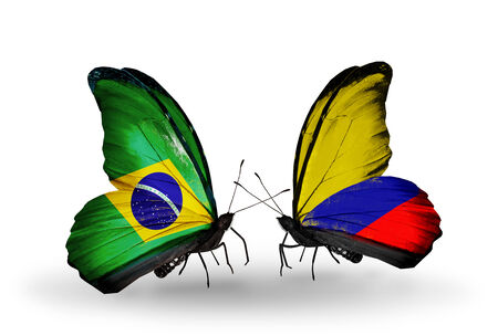 Two butterflies with flags on wings as symbol of relations Brazil and Columbia Stock Photo