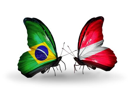 Two butterflies with flags on wings as symbol of relations Brazil and Latvia Stock Photo