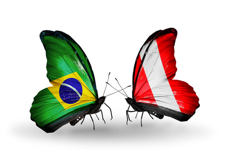 Two butterflies with flags on wings as symbol of relations Brazil and Peru photo