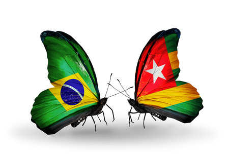 Two butterflies with flags on wings as symbol of relations Brazil and Togo photo
