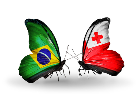 Two butterflies with flags on wings as symbol of relations Brazil and Tonga photo