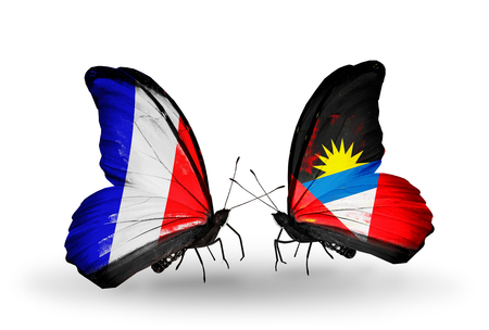 antigua flag: Two butterflies with flags on wings as symbol of relations France and Antigua and Barbuda Stock Photo