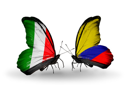 Two butterflies with flags on wings as symbol of relations Italy and Columbia photo