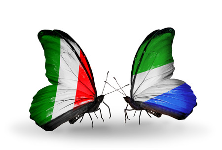 Two butterflies with flags on wings as symbol of relations Italy and Sierra Leone photo