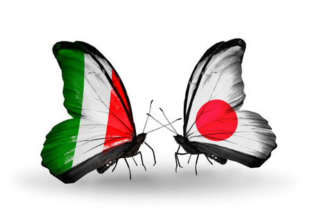 Two butterflies with flags on wings as symbol of relations Italy and Japan Stock Photo