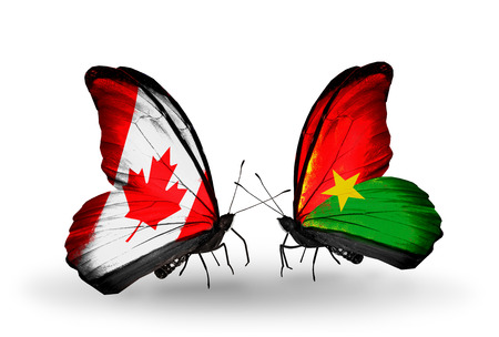 Two butterflies with flags on wings as symbol of relations Canada and Burkina Faso photo