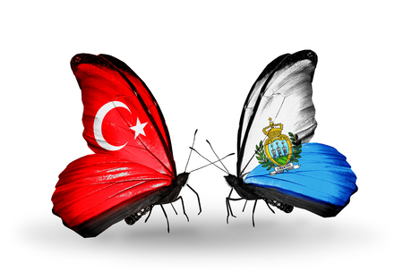 Two butterflies with flags on wings as symbol of relations Turkey and San Marino photo