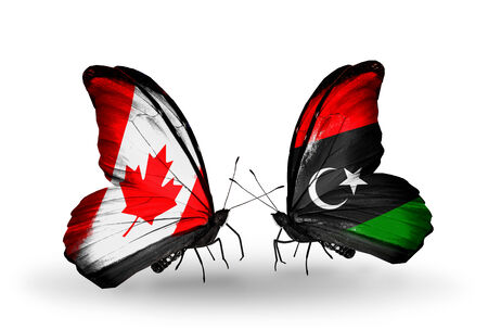canadian military: Two butterflies with flags on wings as symbol of relations Canada and Libya Stock Photo