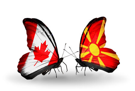 canadian military: Two butterflies with flags on wings as symbol of relations Canada and Macedonia