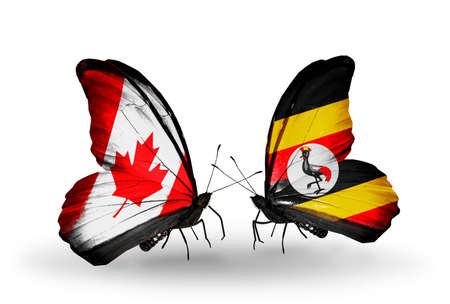 Two butterflies with flags on wings as symbol of relations Canada and Uganda photo