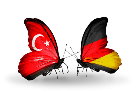 Two butterflies with flags on wings as symbol of relations Turkey and Germany